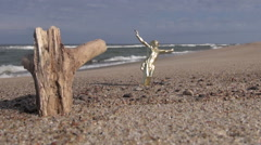 Seascape with crucifix and wooden rustic log in sand Stock Footage