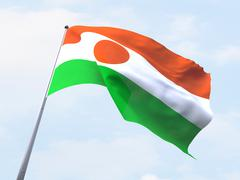 Stock Illustration of Niger flag flying on clear sky.