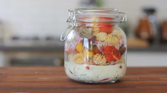 How to make Mason jar Pasta Salad Stock Footage