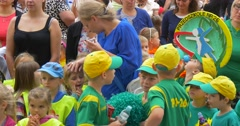 Panorama of Crowd of Children in Colorful T-Shirts Kids Are Laughing Talking Stock Footage