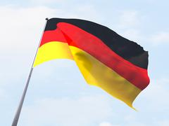 Germany flag flying on clear sky. - stock illustration