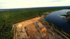 Flight over sand pit and lake. Nature landscape after mining. Aerial footage. Stock Footage