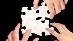 Female and male hands solving a blank puzzle. Alpha matte. 4 in 1. - stock footage