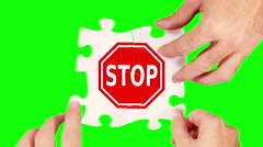 Female and male hands solving a stop sign puzzle. 4 in 1. Stock Footage