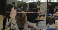 Syrian Refugees Taking Food Donated by Copenhagen Locals Stock Footage