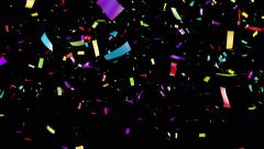 Falling confetti over black background. Alpha matte. - stock footage