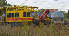 Dry Grass Is On The Foreground Yellow Special Rolling Stock Stands On The Stock Footage