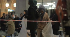 Syrian Refugees Listening to Announcement at Charity Collecting Point in - stock footage