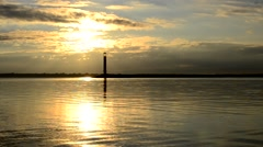 Landscape with motorboat moving on water with lighthouse at dawn.mp4 Stock Footage