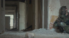 marine with gas mask waiting in abandoned school 4k - stock footage