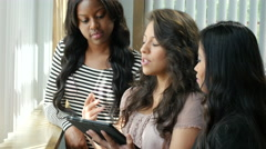 Multi ethnic work team on tablet by window - stock footage