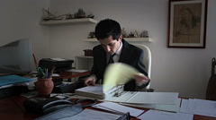 Office: Employee searching archive clients Stock Footage