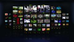 Television studio. Multiple themed videos. Black background. Blurred. - stock footage