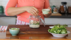 How to make Mason jar Healthy Salad Stock Footage