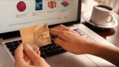 Female hand holding a gold credit card and shopping online. 3 shots. Dolly. Stock Footage