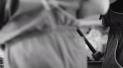 Auto mechanic repairs and lubricates the car. black and white video Stock Footage