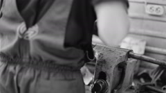 Auto mechanic repairs and lubricates the car. black and white video - stock footage