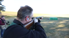 Man firing shotgun over the shoulder Stock Footage