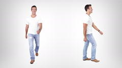 Casual young man walking with alpha matte. Lateral and frontal view. - stock footage