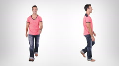 Casual young man walking with alpha matte. Lateral and frontal view. Stock Footage