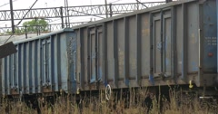 Long Freight Train Moves On Railroad Track Grey And Blue Freight Wagons Stock Footage