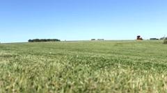 Lawn mowers on grass field 3 Stock Footage