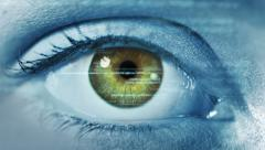 Eye close-up with computer data appearing. Futuristic. Green and brown. 2 in 1. Stock Footage