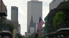 Highrise and us flag in New Orleans french quarter Stock Footage