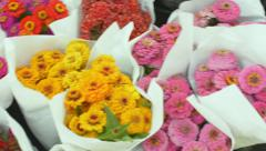 Bouquets of zinna flowers at market Stock Footage