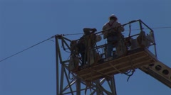 Utility Workers on Power Line - stock footage