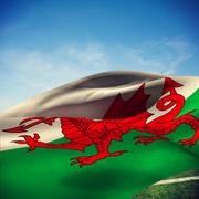 Composite image of waving flag of wales - stock photo