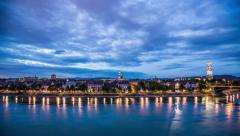 Basel skyline with, river, waterfront, sky with clouds in the evening timelapse Stock Footage