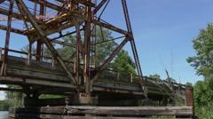 Tracking shot under old drawbridge Stock Footage