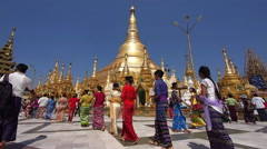 Tourists and Pilgrims at Shwedagon Pagoda in Yangon, Manmar (Burma) Stock Footage