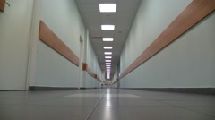 Empty corridor of a building with electric lamps lighting Stock Footage
