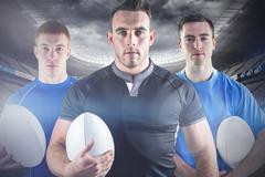 Stock Photo of Composite image of tough rugby players