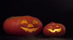 Two halloween pumpkins spew smoke Stock Footage