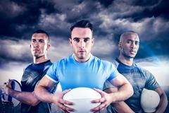Composite image of tough rugby players - stock photo