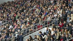 Stadium crowd  fans are closely watching what is happening. - stock footage