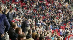 Fans at sporting events closely watching the game of hockey. - stock footage