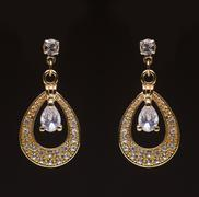 gold earrings with white little stones - stock photo
