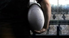 Rugby player standing face the post - stock footage