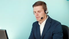 Man in call center smilingly looking at the camera Stock Footage