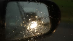 Rain drops on the side window of a car driving through a town Stock Footage