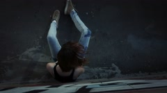 Drug addict girl sits, then falls, dropping syringe. Stock Footage