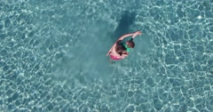 Aerial shot of mother and daughter playing and enjoying in sea waters Stock Footage
