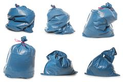 Collection of Blue Rubbish Bags on white - stock photo