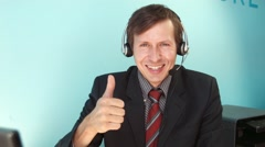 A smiling man in a call center shows great Stock Footage