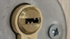 Man Inserts a Key into the Door Lock and Open or Close It - stock footage