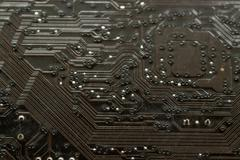 Closeup Macro of a Computer PCB Board - stock photo